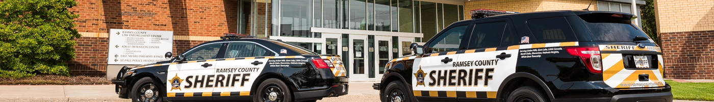 Exterior of Law Enforcement Center with squad cars