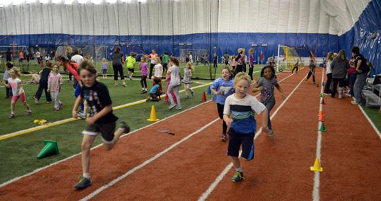 Students running on track at Vadnais Sports Center dome