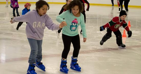 Two young girls skating at Aldrich Arena