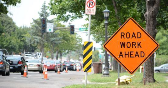 Road work ahead sign with lane of traffic